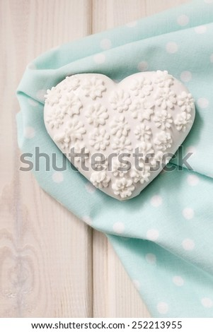 Gingerbread cookie in heart shape decorated with white icing - stock photo