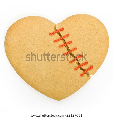 Gingerbread cookie in the shape of a broken heart - stock photo