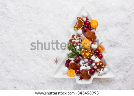 Gingerbread cookies and candy in Christmas setting, selective focu - stock photo