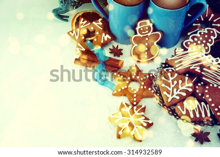 Gingerbread cookies and cups of cocoa.
