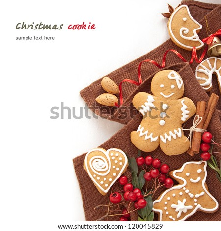 Gingerbread cookies and spices over white background - stock photo