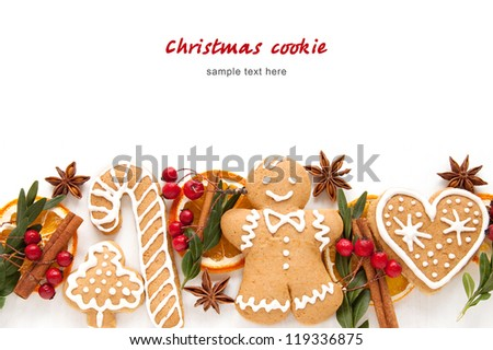 Gingerbread cookies and spices over white background close up - stock photo