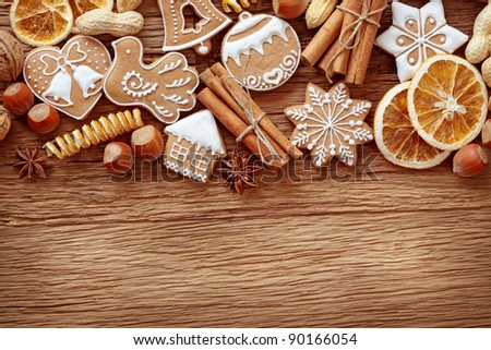Gingerbread cookies and spices over wooden background close up - stock photo