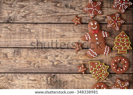 Gingerbread cookies christmas composition on vintage wooden table background frame. Top view. Rustic style.