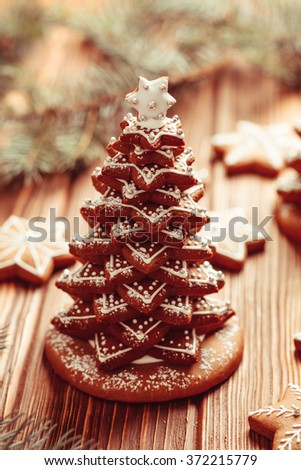 Gingerbread cookies. Christmas tree from cookies with icing on the table - stock photo