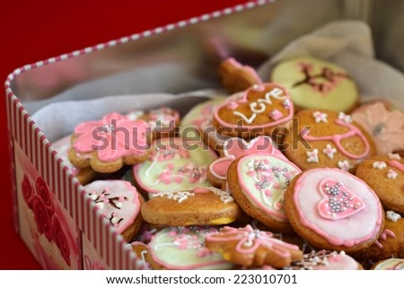 Gingerbread cookies. Decorated home baked gingerbread cookies with colored icing sugar. Ready for Christmas or Valentine's Day - beautiful gift. - stock photo