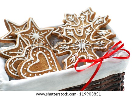 Gingerbread cookies decorated with royal icing arranged in a basket - stock photo