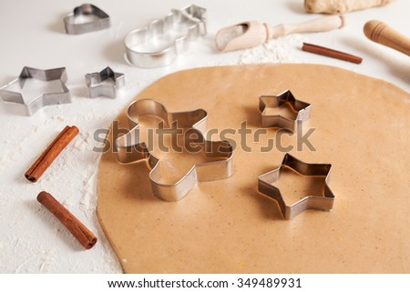 Gingerbread cookies dough preparation recipe with cinnamon and flour on white kitchen table. Traditional homemade christmas dessert - stock photo