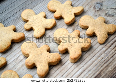 Gingerbread cookies in shape of man on wooden table