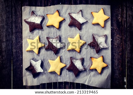 Gingerbread cookies in star shape from above on the wooden background  - stock photo