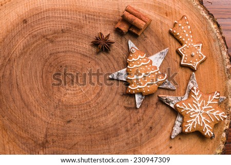 Gingerbread cookies on wooden background - stock photo