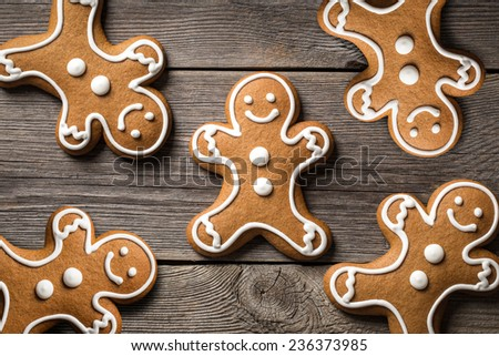 Gingerbread cookies on wooden background. - stock photo
