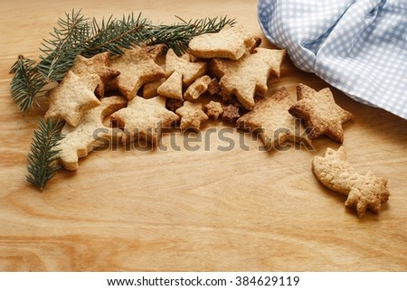 Gingerbread cookies on wooden table, copy space