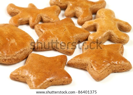 Gingerbread cookies over white. Shallow depth of field - stock photo