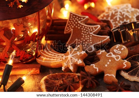 Gingerbread cookies, spices and Christmas lights - stock photo