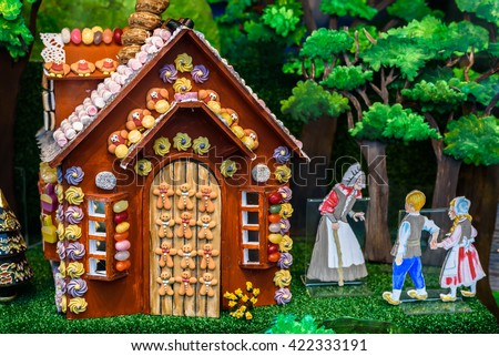 Gingerbread cottage depicting hansel and Gretel in a shop window display.