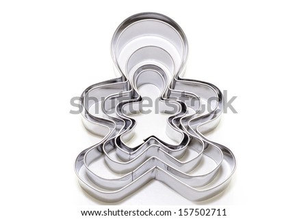 Gingerbread family cutters on white background - stock photo