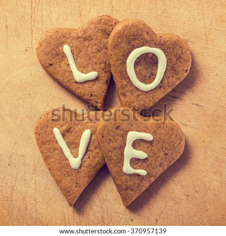 Gingerbread heart cookies on a wooden background - stock photo