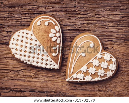 Gingerbread heart cookies on a wooden brown background - stock photo