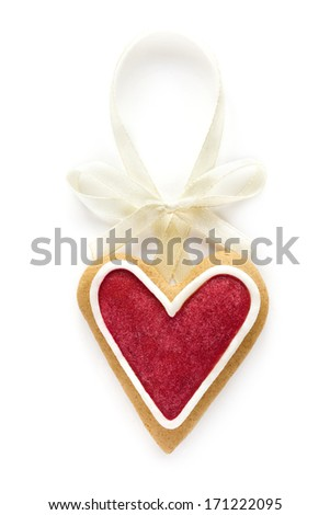 Gingerbread heart with white bow. Love decor. Isolated on white background. - stock photo
