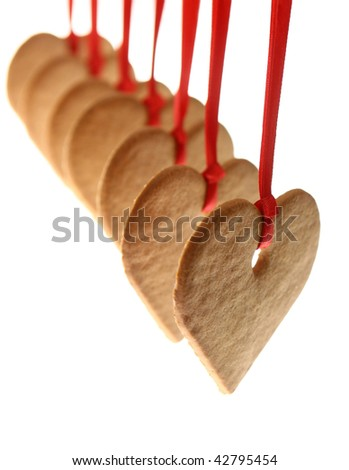 Gingerbread hearts and red bow isolated on white background - stock photo