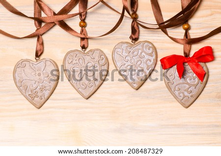 Gingerbread hearts on the wooden background for Valentine's day