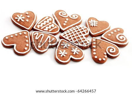gingerbread hearts on white background - sweet food - stock photo
