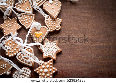 Gingerbread home baked on wooden background