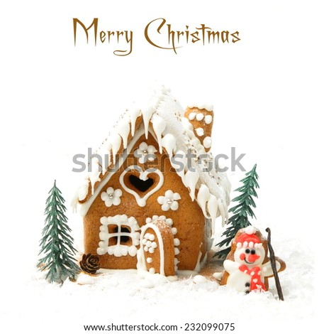Gingerbread house and a snowman - stock photo