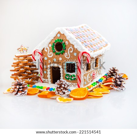 Gingerbread house, christmas tree and candida on a white background - stock photo
