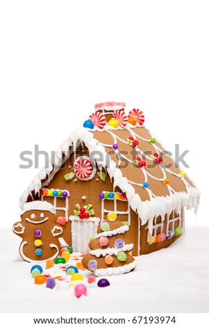 Gingerbread house, man and Christmas tree covered with snow and colorful candy on a winter landscape, isolated. - stock photo