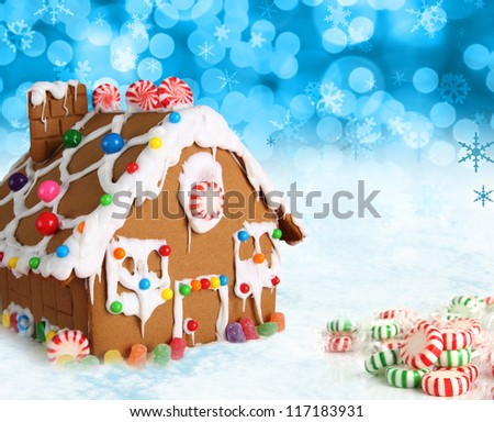 Gingerbread house on a festive Christmas snow background. - stock photo