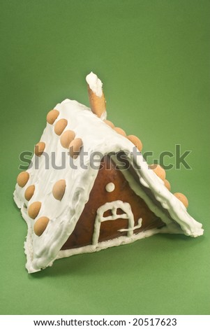Gingerbread house on green background - stock photo