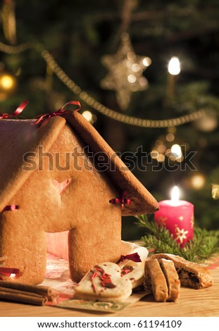 gingerbread house with cake - stock photo