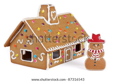 Gingerbread House with Gingerbread Snowman, Isolated - stock photo