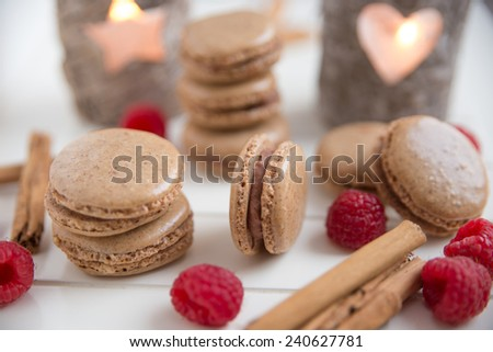 Gingerbread macarons with chocolate raspberry ganache filling - stock photo