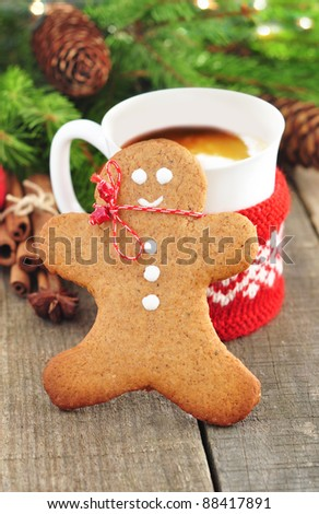 Gingerbread man and cup of coffee - stock photo