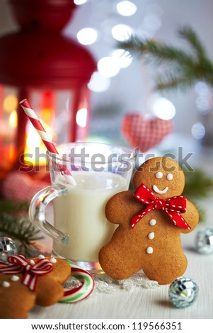 Gingerbread man and cup of milk for Santa - stock photo