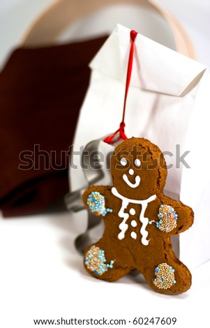 gingerbread man and gift bag closeup on white background - stock photo