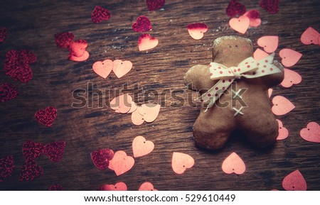 Gingerbread man and heart on a dark background. Studio shooting. Subject shooting.