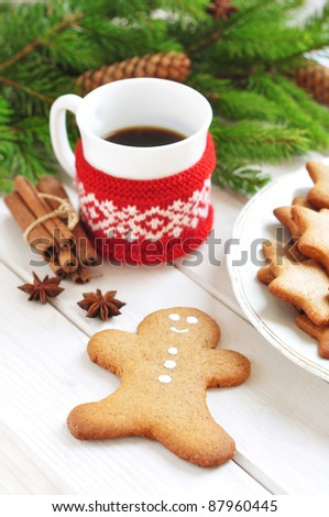 Gingerbread man cookie and cup of coffee - stock photo