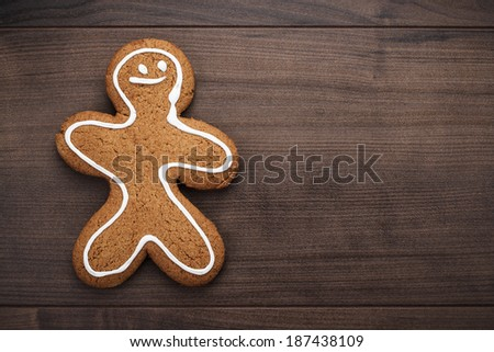 gingerbread man cookie on the wooden background - stock photo