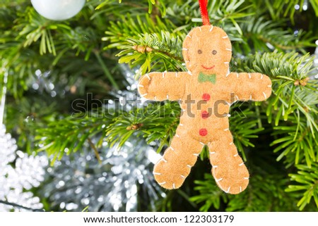 Gingerbread man decoration on a christmas tree background