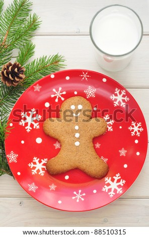 Gingerbread man on a decorative plate - stock photo