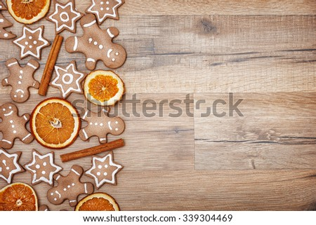Gingerbread on wooden background - stock photo