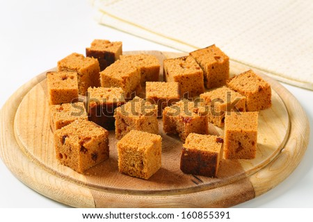 gingerbread pieces on a wooden cutting board