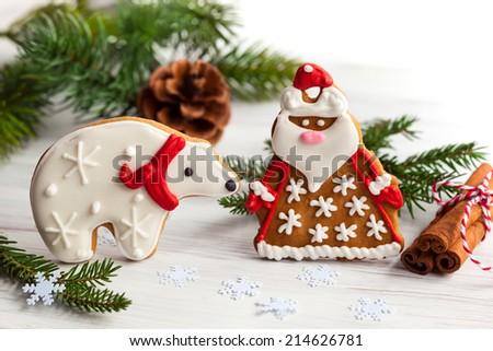 Gingerbread Santa Claus and polar bear with Christmas decor - stock photo