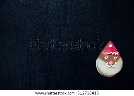 Gingerbread Santa Claus on black with space for text