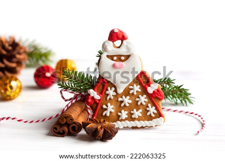 Gingerbread Santa Claus with Christmas decor - stock photo
