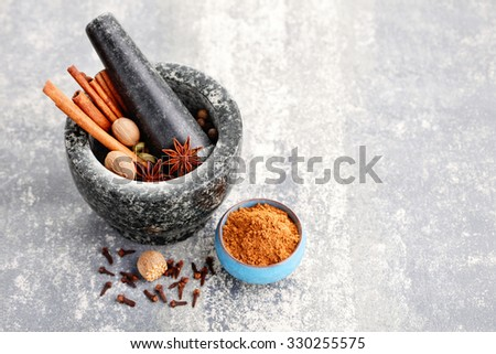 gingerbread spices with mortar and pestle - stock photo